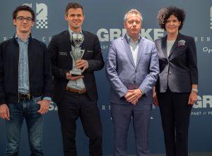 Caruana, Carlsen og Naiditsch med Antje Leminsky fra GRENKE AG