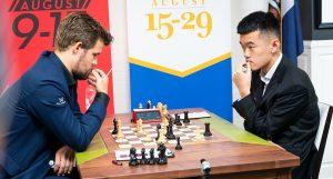 Carlsen presset, men Liren Ding berget remis