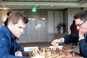 Carlsen og Caruana spilte remis i niende runde