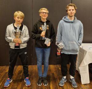 De tre norske medaljevinnerne: Haug, Strand og Vestby-Ellingsen